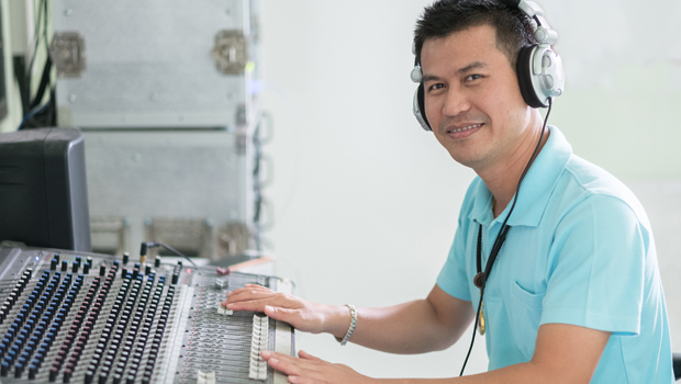 Man works on sound board