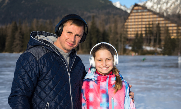 Quebec father and daighter listen to programming outside